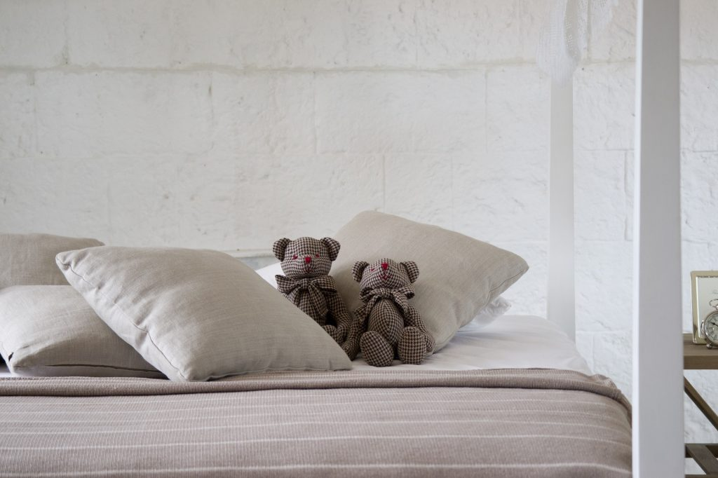 Image of a fresh, cosy bed with bears