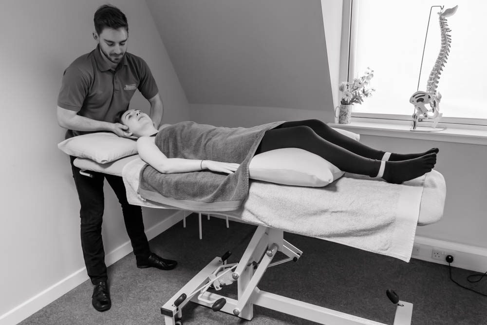 Osteopath at Bearsden Osteopaths giving treatment to a young lady for neck pain