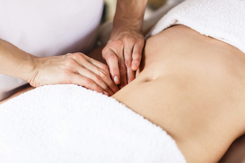 Lady receiving stomach massage
